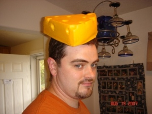 Not everyone is excited to wear the cheese hat at a fondue party.